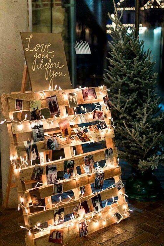 Festa decorada com varal de fotos no palete