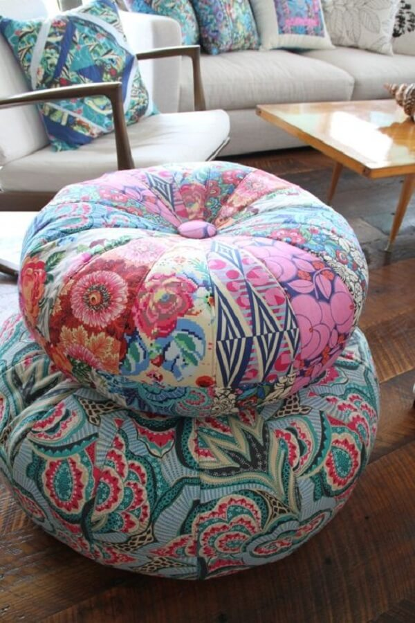 living room decorated with wooden armchair and round patchwork fabric puff