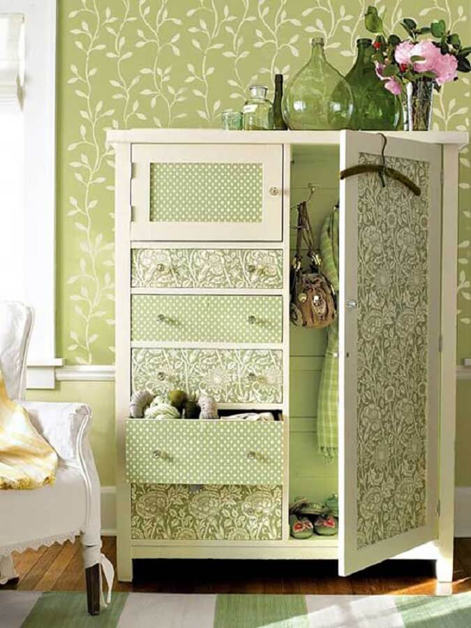 antique cabinet decorated with patchwork of fabrics