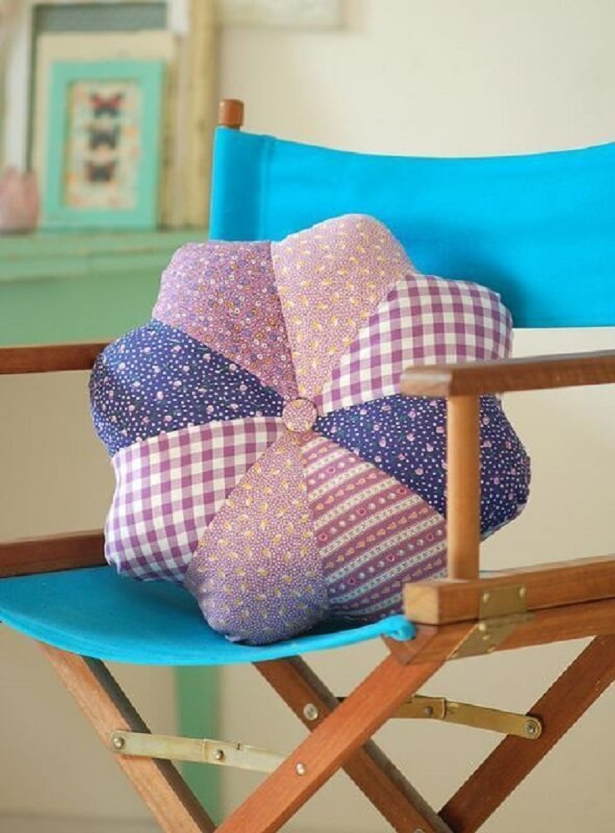 chair decorated with fabric patchwork cushion