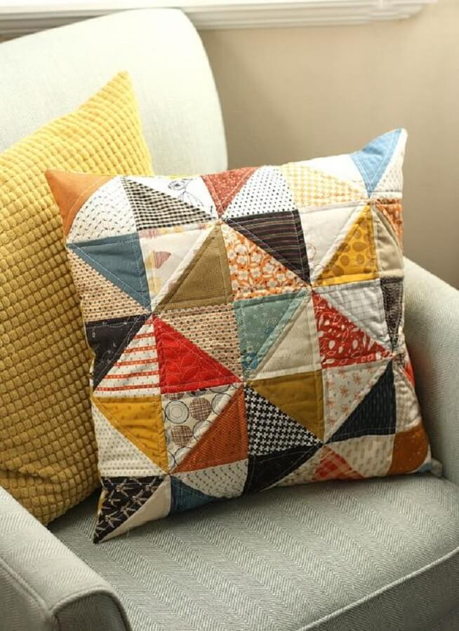 decor with colorful patchwork cushion and gray armchair