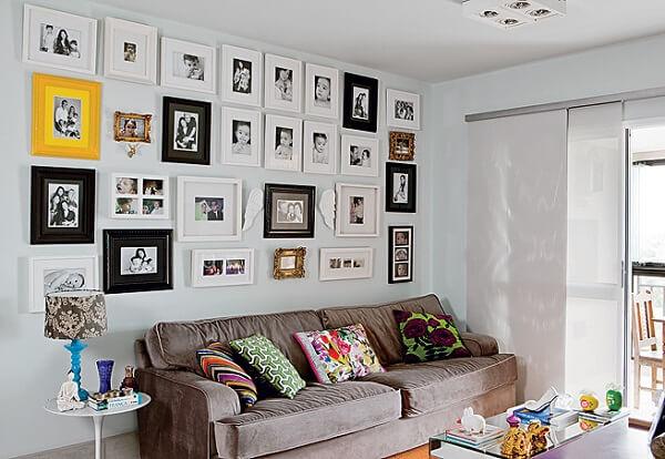 Quadro de fotos para parede compondo a decoração da sala de estar
