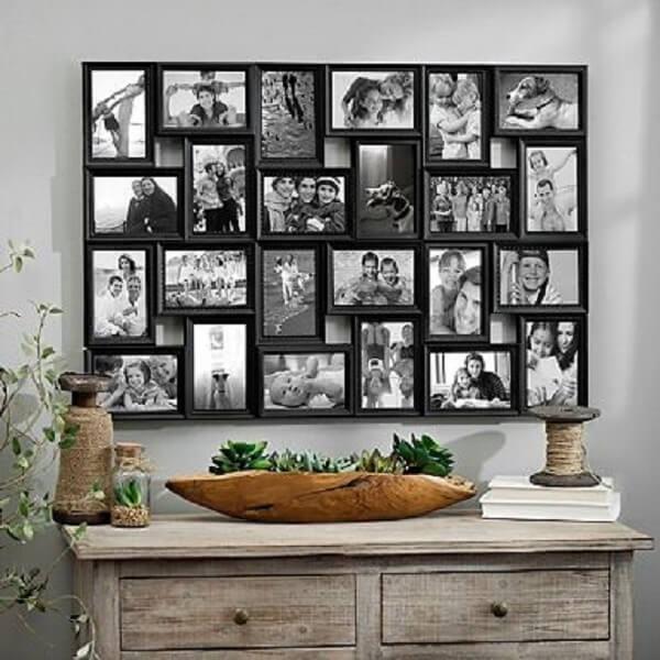 Quadro de fotos compõe a decoração acima da cômoda